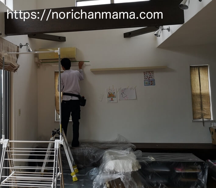 Specialist is cleaning an air conditioner