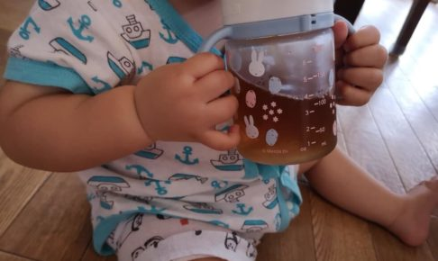 Baby drinking with straw mug